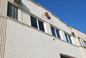 Rubí > Reparació de Goteres en el coronament d'una Nau Industrial